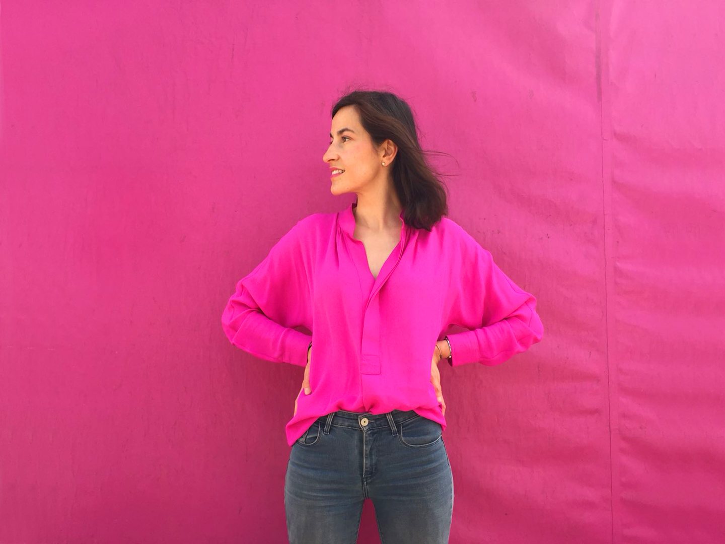 Style Indigo wearing a pink dress as a shirt to achieve the 30 wears challenge