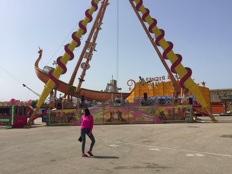 Style Indigo wearing a pink dress as a shirt in a amusement park